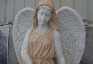 statue of a weeping angel sitting on a bench in the past many of our