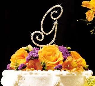 This striking Gold crystal initial monogram wedding cake topper