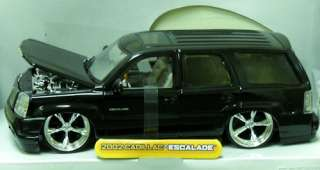 this auction is for black 2002 cadillac escalade diecast model car