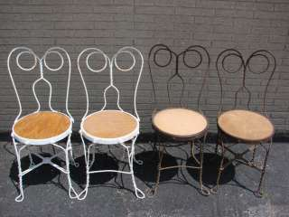 three white colored wrought iron chairs on popscreen