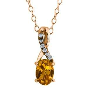 0.54 Ct Oval Orange Tourmaline and Diamond Gold Plated