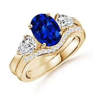 Oval Sapphire and Diamond Three Stone Ring in Yellow Gold